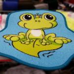 Frosch auf Fußmatte